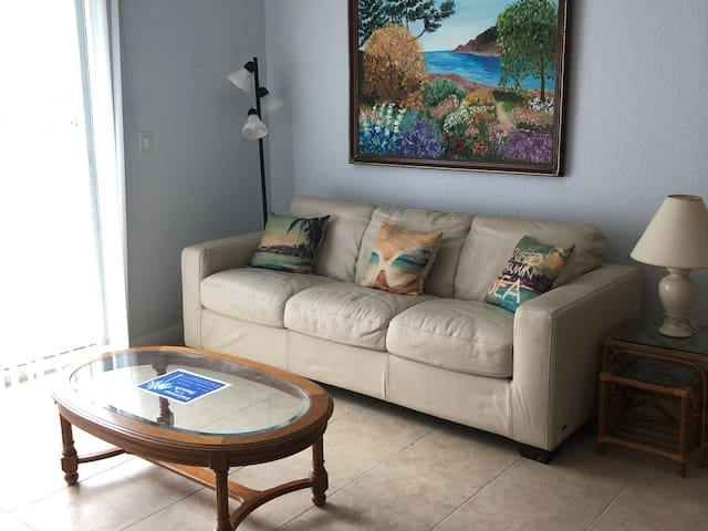 Bright & new condo only steps from the beach & bay