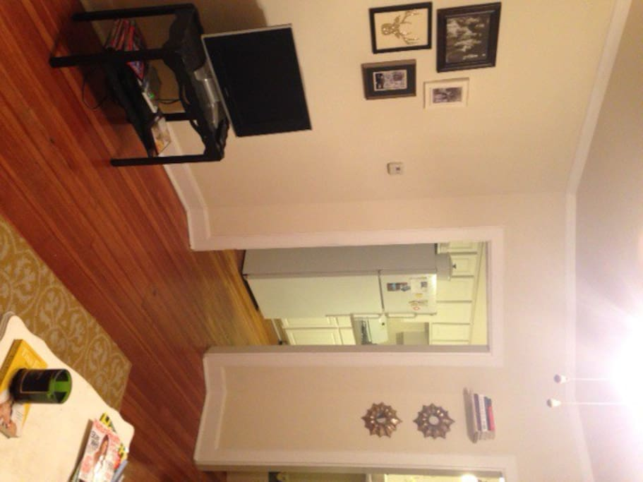 The open layout of the main floor combines the dining room, living room, and kitchen spaces