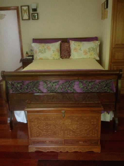 Queen-sized bed w/very comfortable mattress. sheets & down pillows.