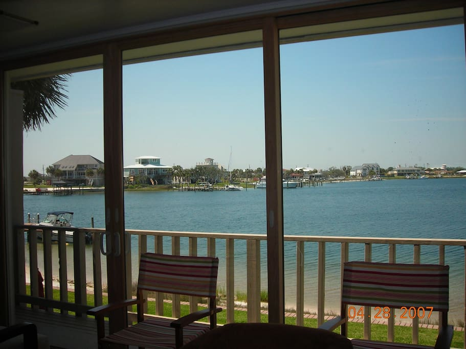 Old railing/living room view of Sabine Bay. This is where the sunsets are! 20 ft of glass.