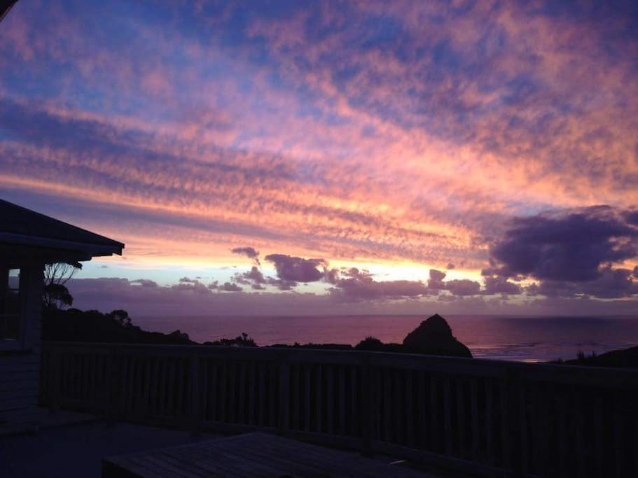 Outstanding sunsets over Lion Rock from the deck.