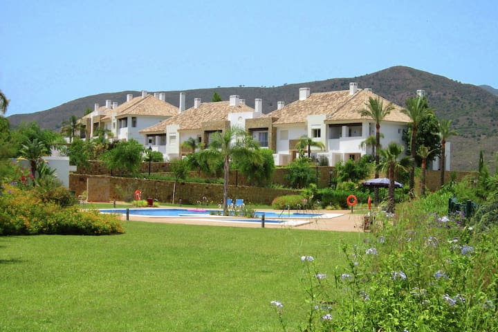Adjoined holiday home is located on the 5 star La Cala Golf Resort