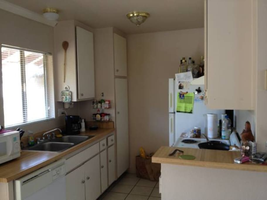 Full kitchen with coffee maker and microwave