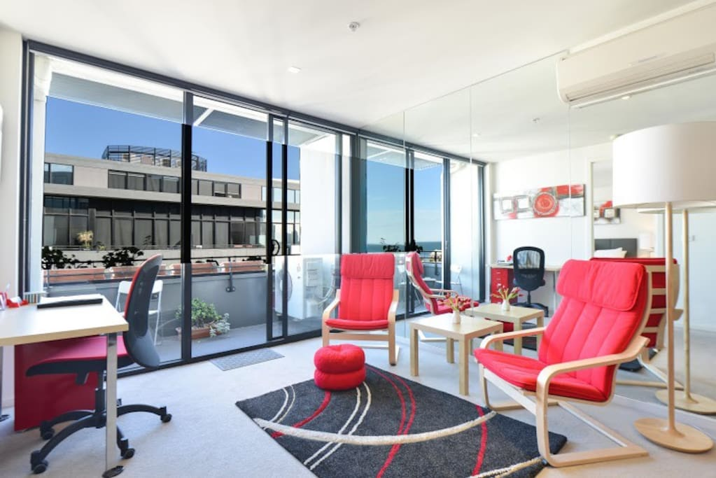 A sea view from every point in the apartment via the wall of mirrors at this 1-bedroom StayCentral Serviced Port Melbourne apartment