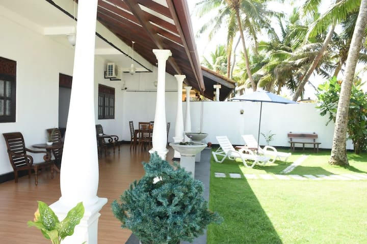 Ashen's Beach House  (Beach front Villa)