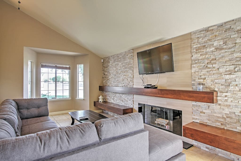 The spacious living room features a 55-inch flat screen TV.