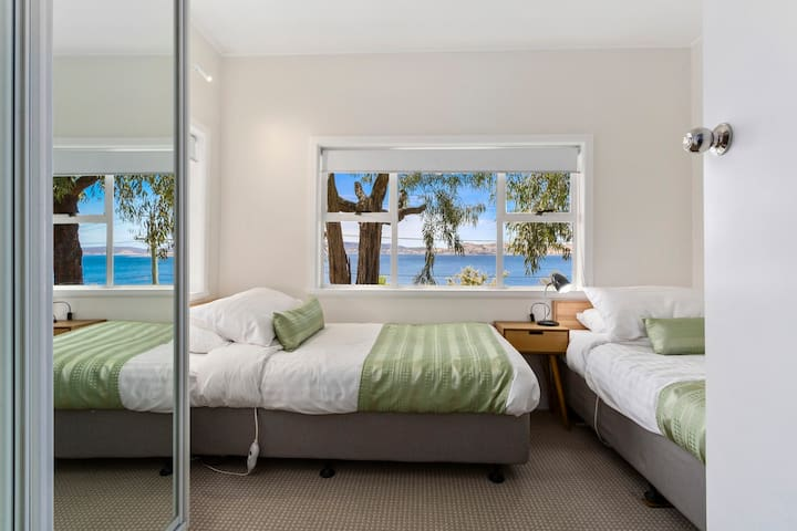 Downstairs twin single bedroom with water views and built in wardrobe.