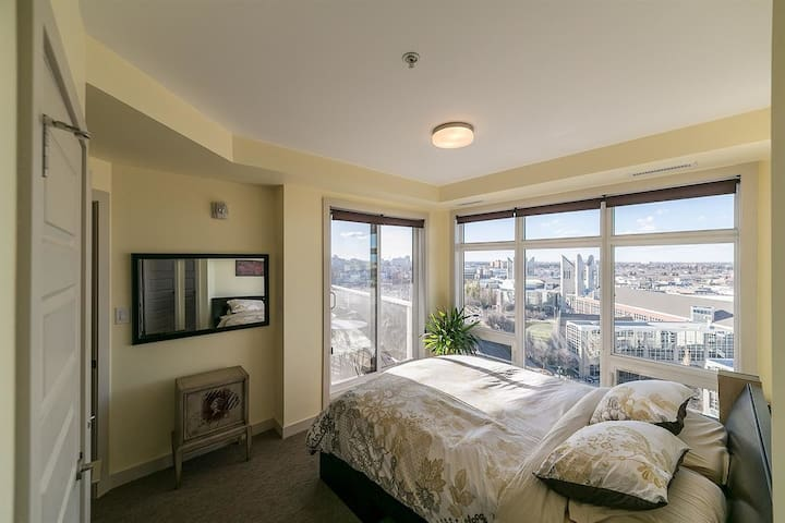 Master suite with two walls of windows