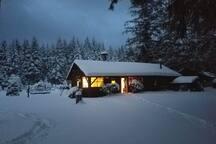 Rustic cabin in winter snow.