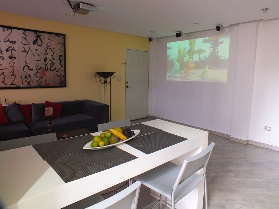 Dinning / Living Room with TV video projector.