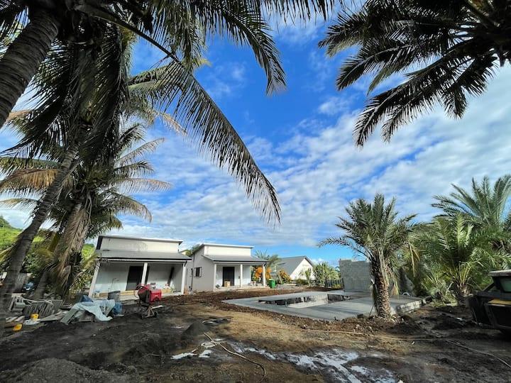 Lodge dattier avec piscine et jardin tropicale.