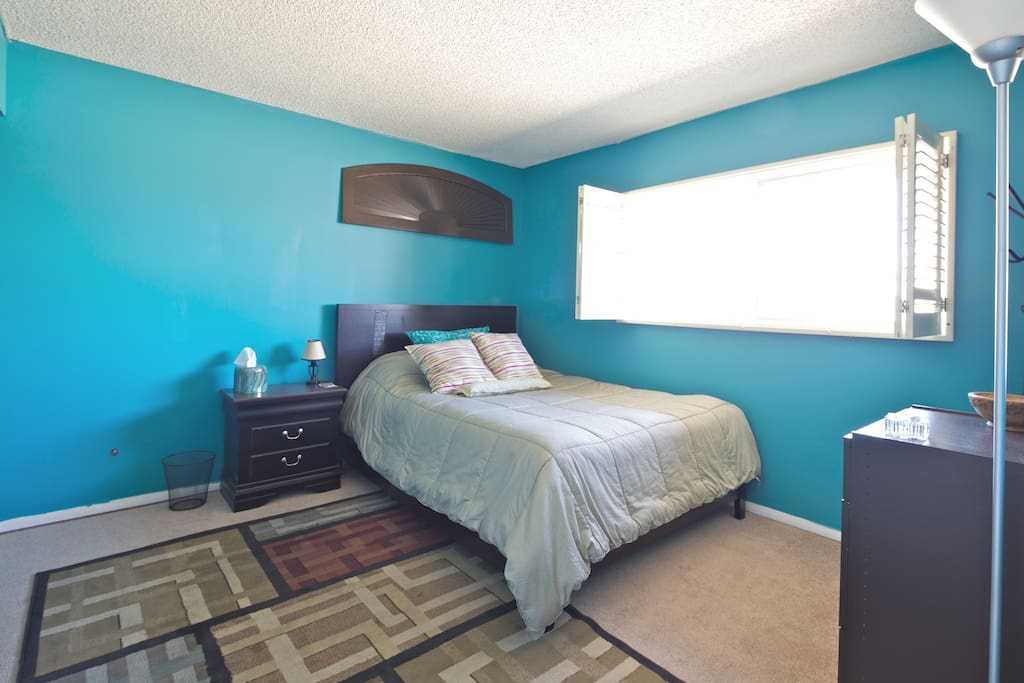 Master bedroom  with comfy queen size bed. Lots of sun each day with hangers and dressers for use.