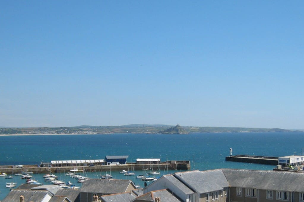 Look out over Mounts Bay, Penzance Harbour, St. Michael's Mount, and lots and lots of weather.