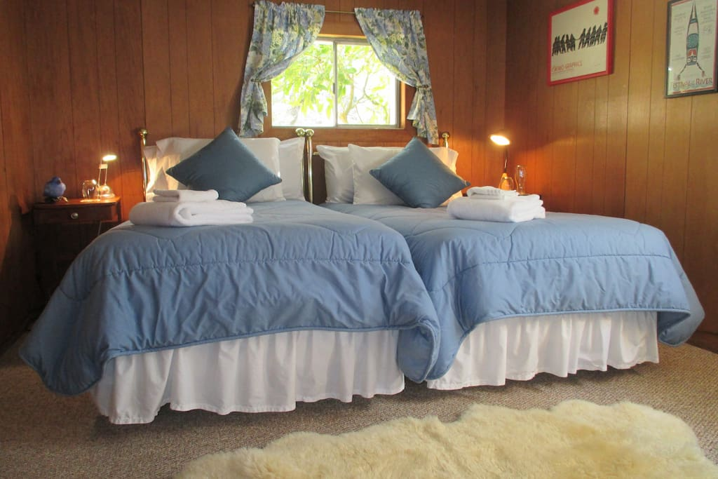 Comfy twin beds which can be reconfigured to a king bed. East window captures the early morning sun.