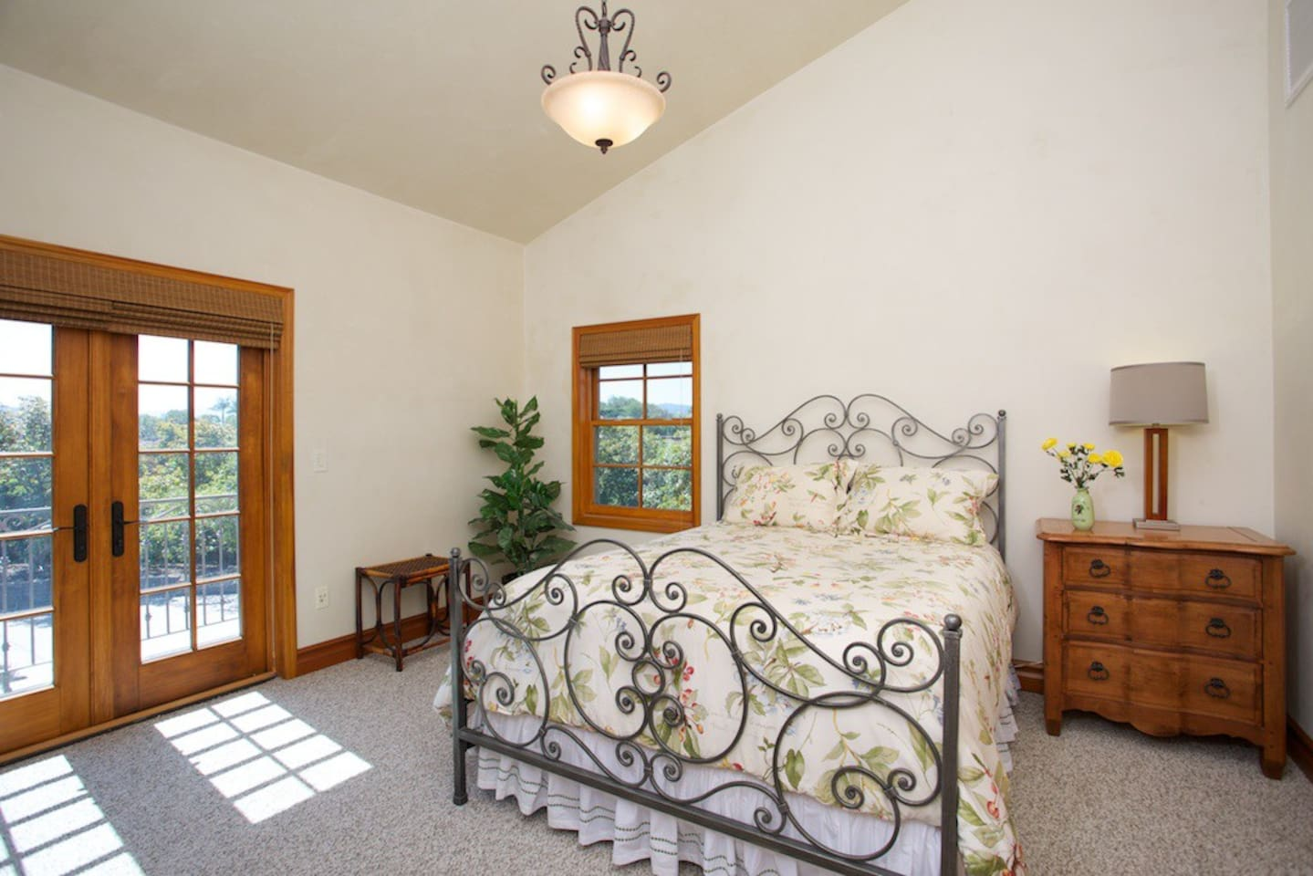 Furniture includes French Queen Bed, Bassett Chest of Drawers and Night Table. Double French Doors open to Sunrise Balcony with a easterly panoramic view of Bonsall.