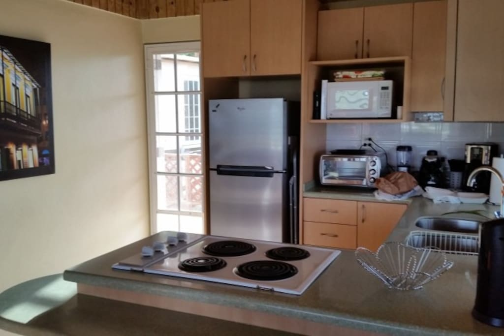 Fully equipped kitchen with Microwave, espresso maker and toaster oven