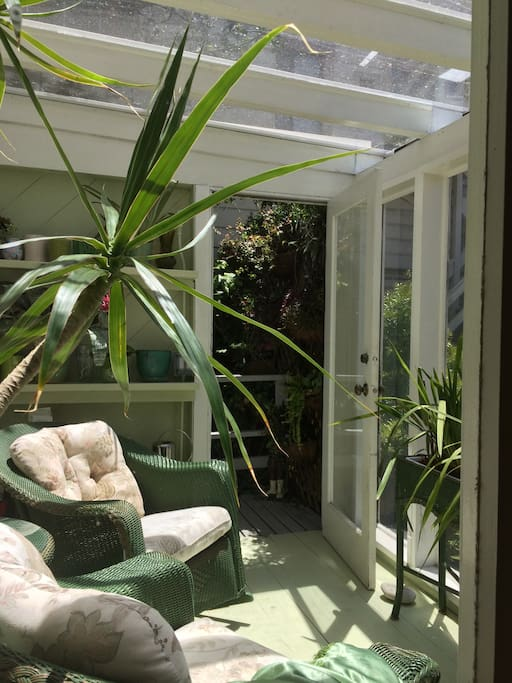 Share small sun room which opens onto garden.