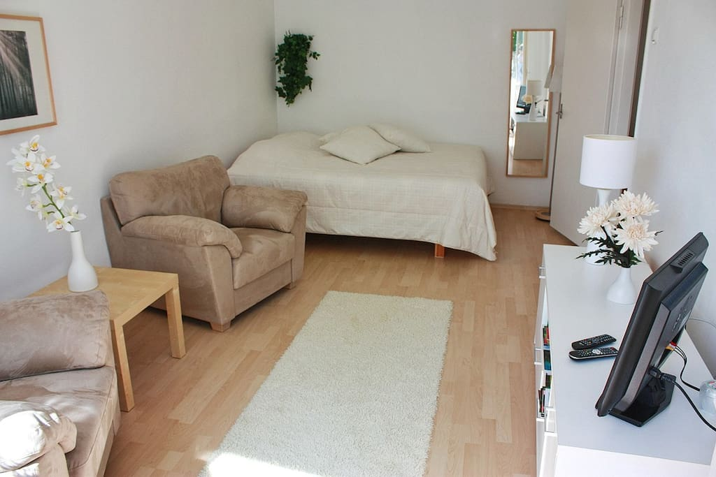 Large double bed, two comfortable armchairs