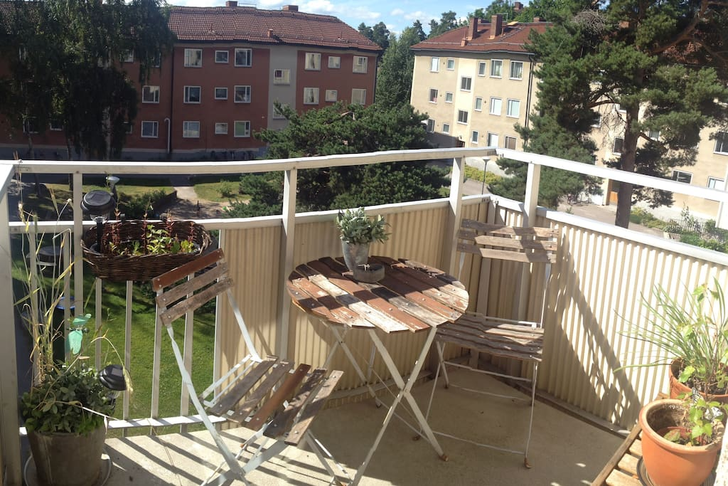 Sunny balcony with coffe table and courtyard view.
