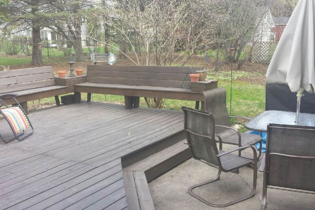 Back yard deck with gas grille and patio furniture.
