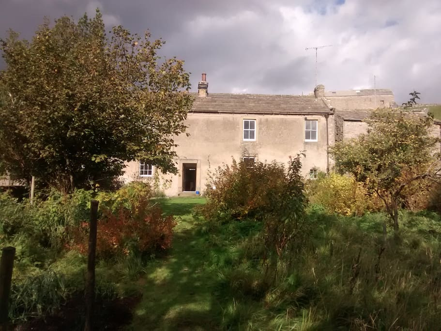 An old farmhouse set in eight acres, with garden, orchard and river frontage