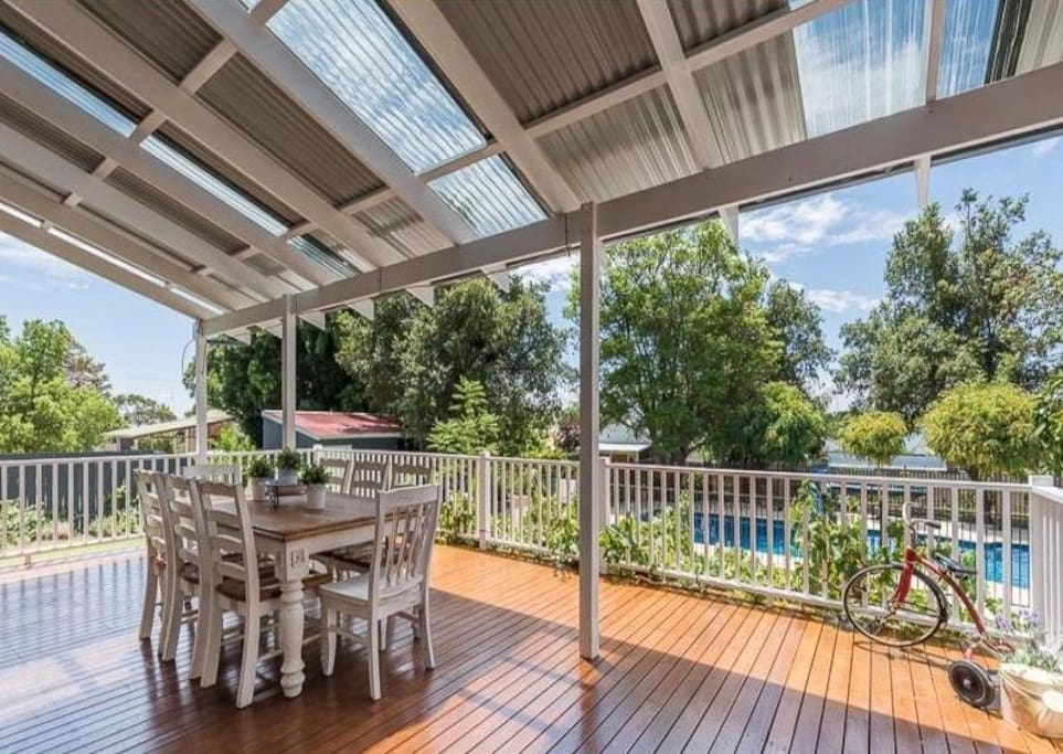 Large entertainment deck with views over the stunning pool and yard  - all set on half an acre of lush lawns and gardens.