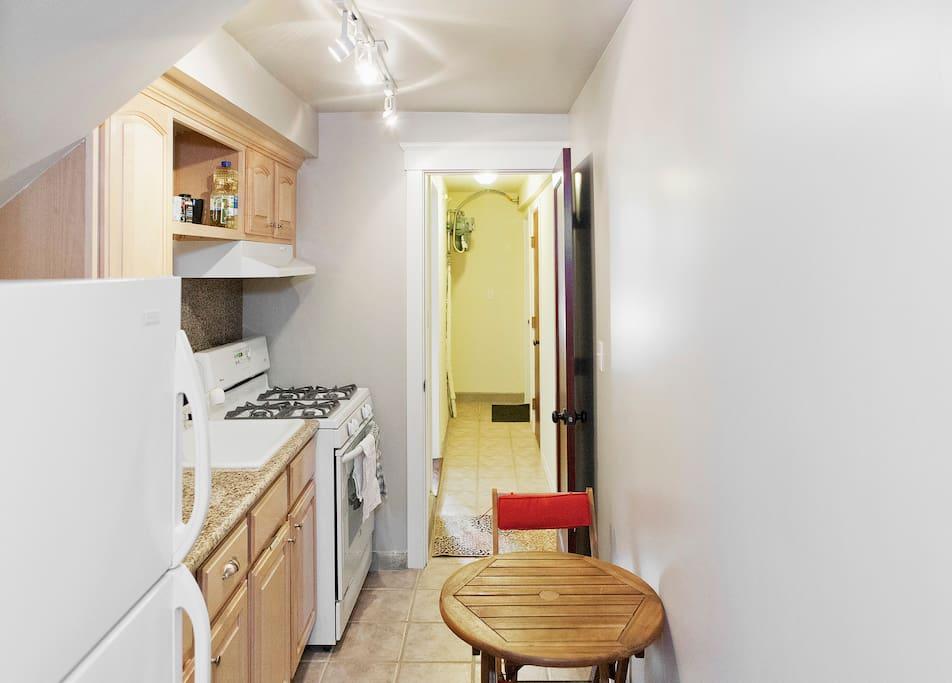 Fridge, stove, oven, dining area
