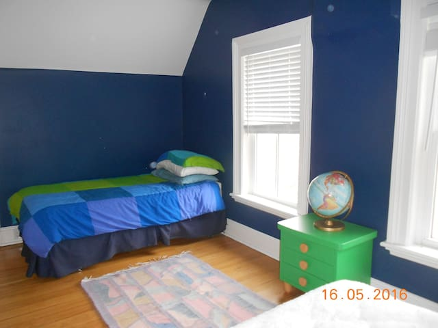 Upstairs bedroom with single bed for adult or child