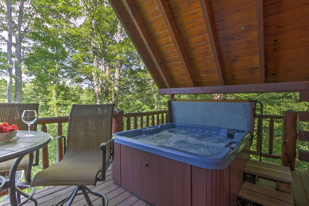 Soak your cares away in the private hot tub.