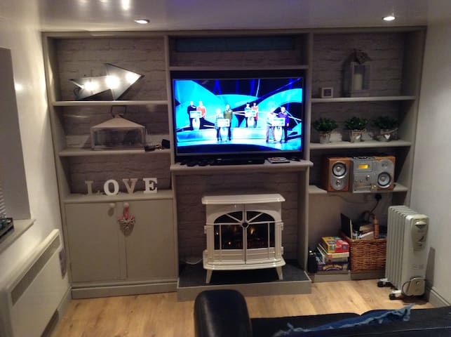 Large screen TV with DVD player & electric log burner effect heater