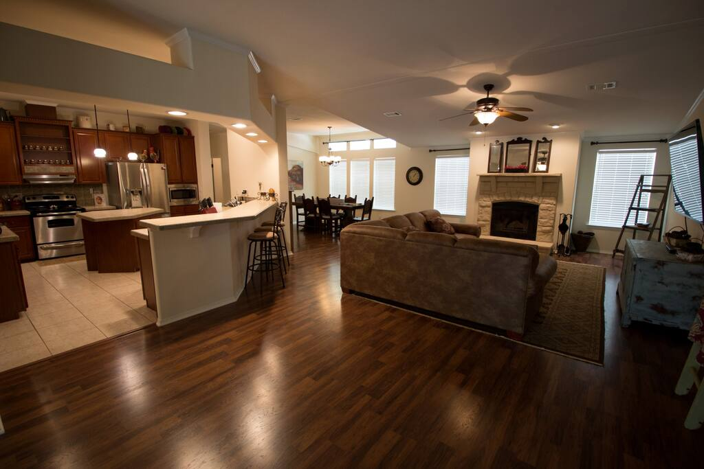 Living, Fireplace, Dining, Bar, Kitchen...open concept for entertaining.