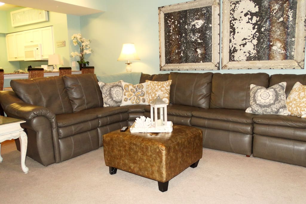 The grand leather sectional is also a queen size sleeper sofa
