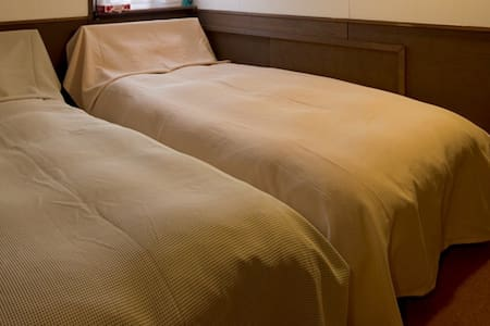 Hirafu Lodge 343 - single bed & breakfast - Chambres d'hôtes