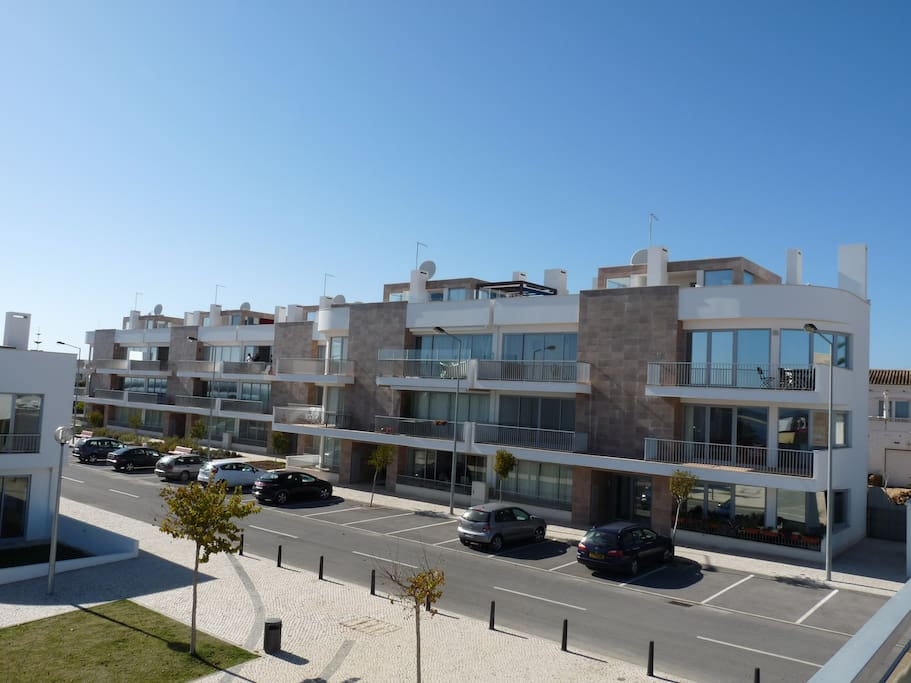 front of apartment blocks with parking outside
