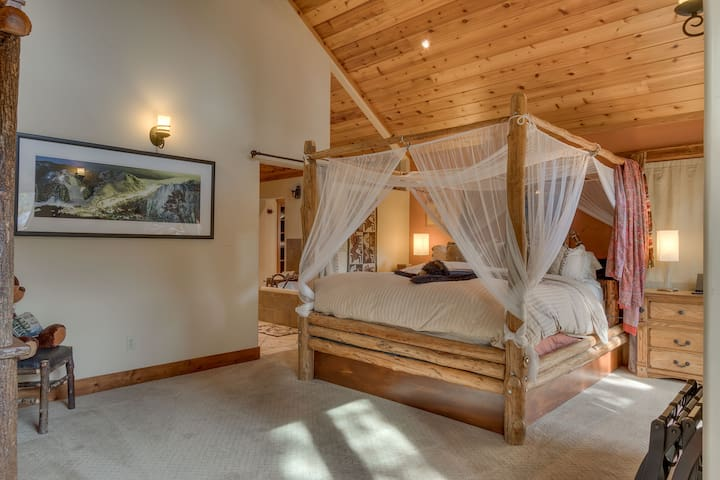 Four poster king bed in the upstairs master