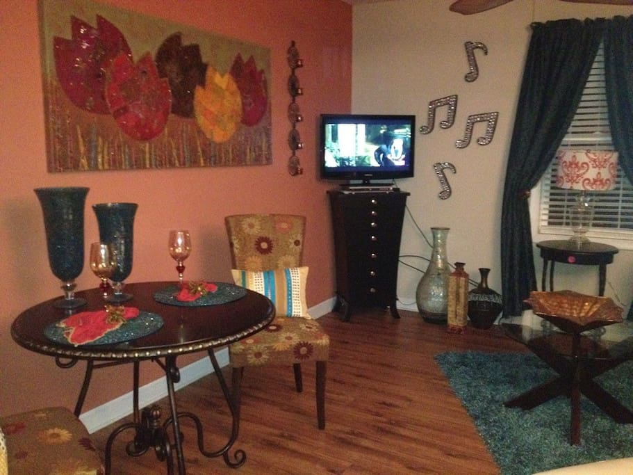 Living Room with dining area, TV, and DVD player