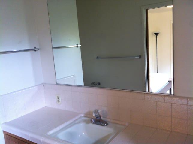 Tile vanity with full mirror