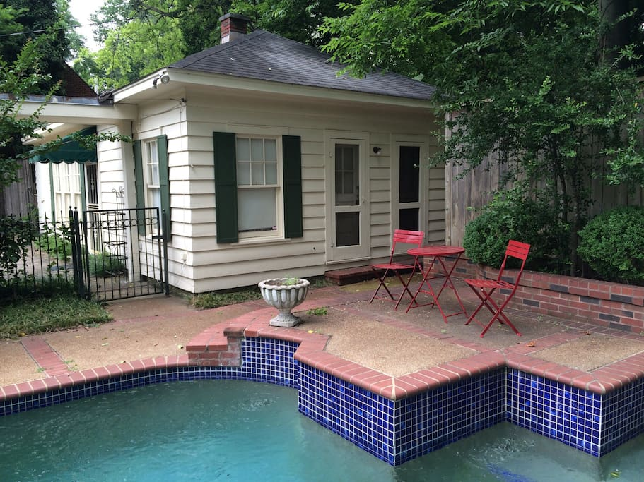 Beautiful and private carriage house next to flowing fountain and pool.