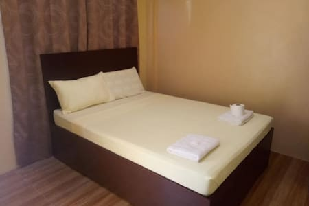 Clean and Affordable Room | Khrysby Pension House