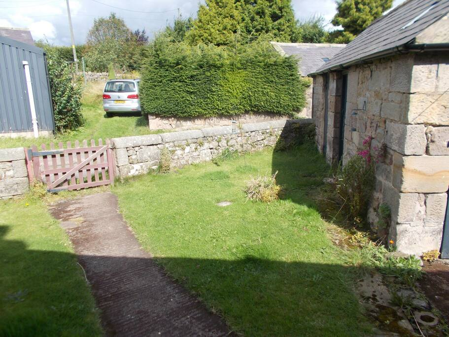 Enclosed garden with larger garden beyond with parking. Secure store with garden furniture and BBQ. Can be used to store bikes.