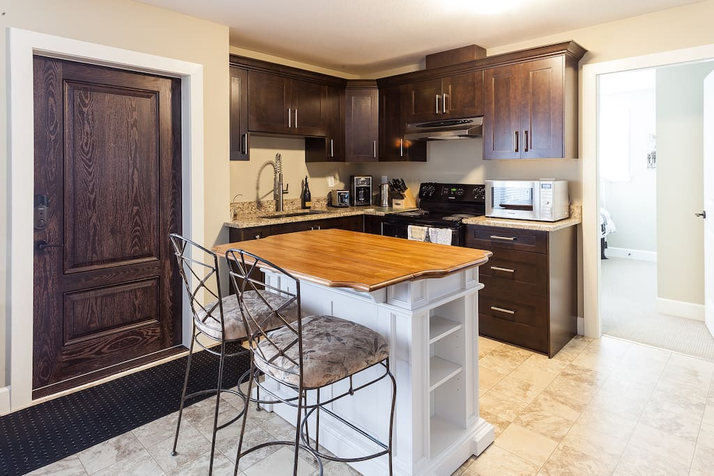 Kitchen equipped for living.  We include small blender, coffee maker, some coffee, sugar/whitener  & tea, microwave, toaster, kettle, cooking utensils, pots & pans, plates & flatware, cups, glasses, new appliances including dishwasher.
