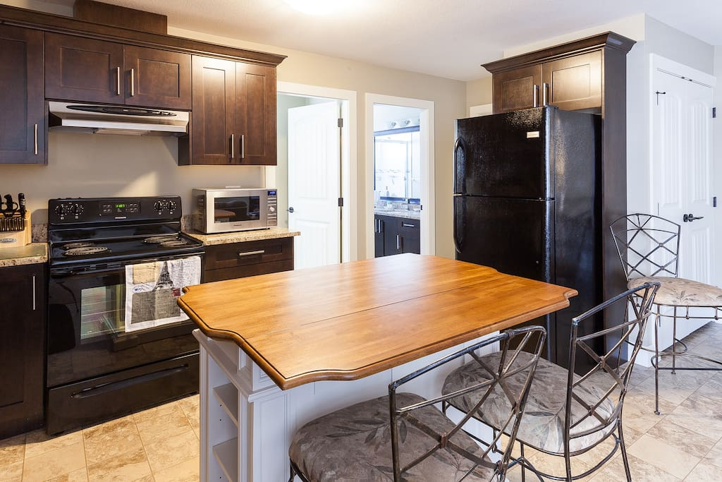 Kitchen Island with seating, counter space & storage.