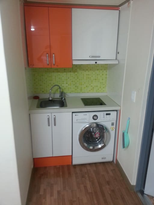 Kitchen with laundry machine with induction range