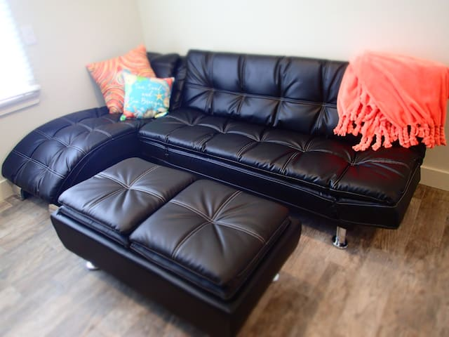 Leather couch with bench that turns into a table