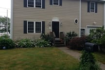 Front of the house. Your private entrance is on the side.