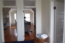 Hall looking into 2 huge identical bedrooms