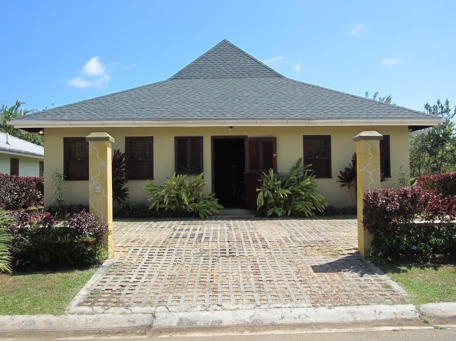 Front of Bungalow villa with adequate parking.
