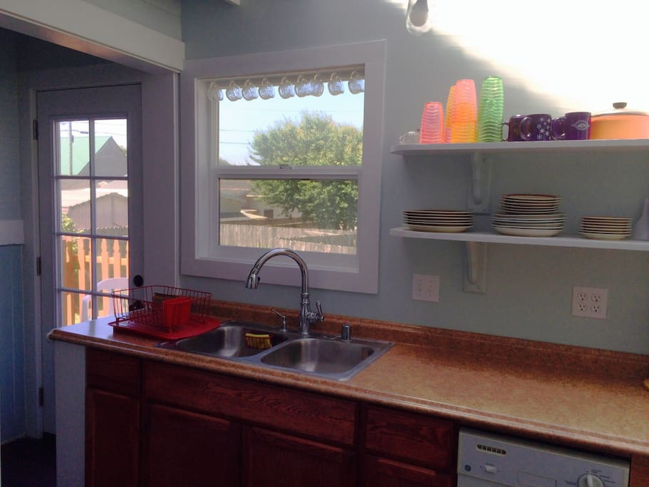 A delightful area for food preparation. A high speed blender, food processor and juicer are just some of the items in this well stocked kitchen. Open the window to let in the fresh sea breezes or go out and relax on the deck in the sun.