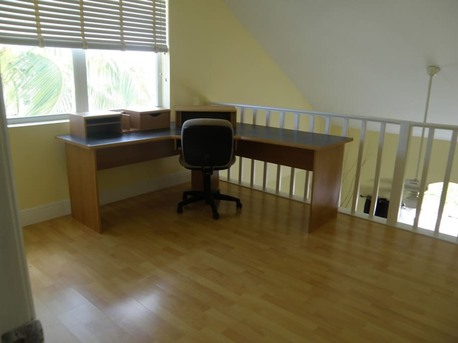 Loft overlooking Living Room.  A  twin bed is located now to the left of the desk.