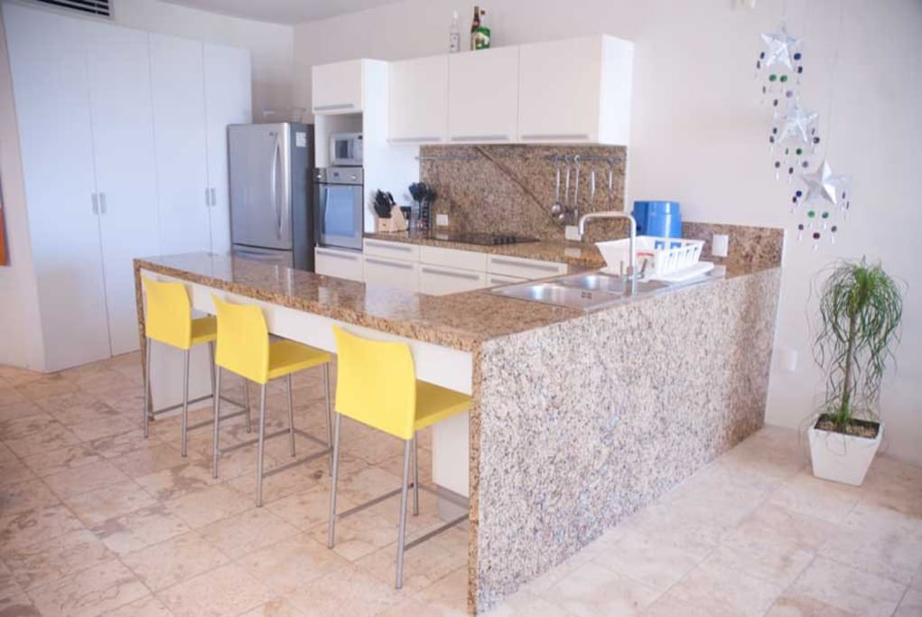 Kitchen has an open space concept and its fully equipped